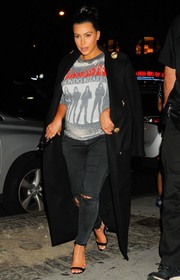 e124a65a8ff2 Kim Kardashian spruced up her rugged tee and jeans combo with a black  Balmain military coat