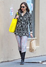 Maggie Gyllenhaal paired her striped pants with knee-high black boots for Christmas shopping in NY.
