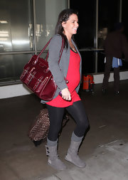 Melissa Rycroft stayed cozy in gray knit boots, which she donned over slouchy socks and black leggings.