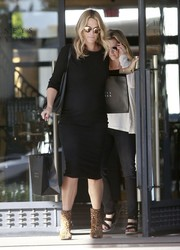 Molly Sims was spotted at Barneys New York wearing a black maternity sweater dress.