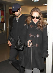 Natalie Portman arrived at the airport in a pair of classic black Ray-Ban wayfarers.