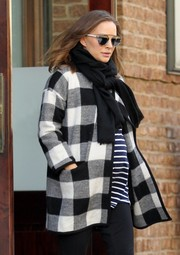 Natalie Portman kept warm with a black scarf and a checkered coat while out in New York City.