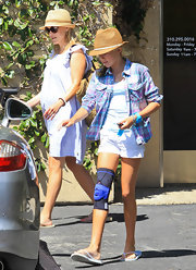 Ava looks cool in the California heat with an un-buttoned plaid shirt.