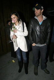 Rachael Leigh Cook took time to stop and smell the flowers wearing a pair of slouchy black mid-calf boots.