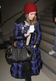 Rachel Bilson made her way through LAX with a studded black leather Knight bag.
