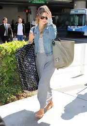 Rachel Bilson showed off her leather tote bag, while leaving LAX airport.