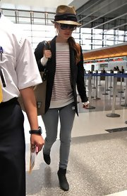 The actress made her way through LAX while sporting her fave pair of Ray-ban shades with a straw fedora hat.