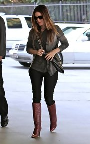 Rachel wore a knee high pair of burgundy leather boots. The classic boots were a sophisticated cold weather look.
