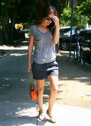 Rachel's relaxed pair of chino shorts were a stylish complement to her slouchy gray tee.