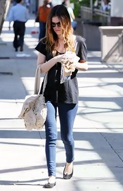 "Rachel completed her casual skinny jeans look with a sweet pair of black suede ""Marjorie"" balled flats."