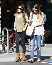 The always fashion forward Rachel Bilson rocks tan lace up ankle boots. She pairs the wedged boots with skinny jeans and a slouchy shirt.