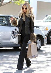 Rachel Zoe looked relaxed, yet elegant running errands in soft flared trousers.