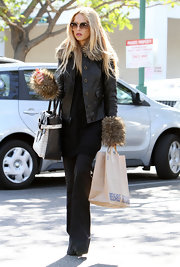 Rachel Zoe chose a leather jacket with an exotic twist in the form of over-the-top fur cuffs.