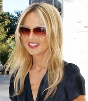 Rachel Zoe sported a pair of oversized rose colored sunglasses with white frames.