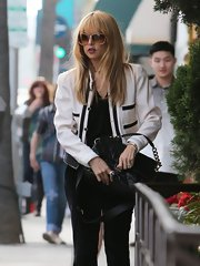 Rachel Zoe chose a cream and black blazer for her minimalistic but classy daytime look.