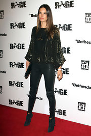 Leather pants worked perfectly with Alessandra's glitzy loose top.