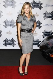 Julie wore classic peep toe platform pumps with a belted, button-down dress.