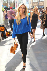 Tamra Barney teamed her billowing blouse with fitted black skinny jeans.