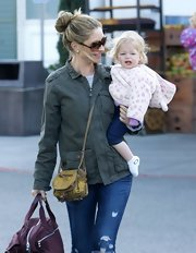 Rebecca Gayheart opted for a classic green utility jacket for her every day look while out with her daughter.