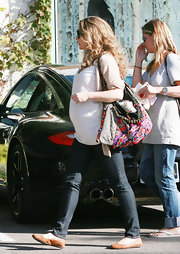A very pregnant Rebecca Gayheart is seen here leaving a salon with a very colorful hobo bag, which looks bona fide retro 60's.