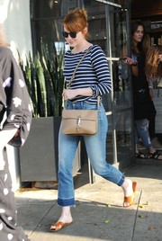 Emma Stone was casual-chic in a blue and white striped boatneck sweater by Amour Vert while visiting the salon.