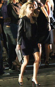 Reese was spotted on the set of her new film where she showed off a snakeskin zip around clutch.