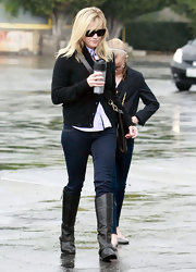 Reese Witherspoon wore flat brown knee high boots to church.