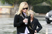 Actress Reese Witherspoon and her fiance Jim Toth take her kids Ava and Deacon to church in Santa Monica, CA.