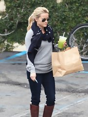 Reese Witherspoon bundled up in a navy scarf with a white square print for her outing in Santa Monica.