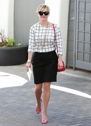 For a pop of color to her monochrome outfit, Reese Witherspoon wore a pair of hot-pink peep-toes.