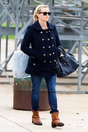 Reese matched her leather tote to her pea coat and jeans while out for a soccer game.
