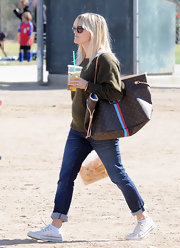 Reese gave her gigantic LV tote bag a personalized touch with monogrammed initials.