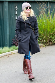 Reese Witherspoon looked adorable in cognac riding boots.