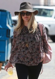 Reese Witherspoon tried to go incognito with a brown walker hat and a pair of cateye sunnies while out in Beverly Hills.