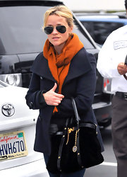 Reese Witherspoon beat the winter blues in a burnt orange scarf while out in Brentwood.
