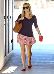 Reese topped off her street style with chic red flats.
