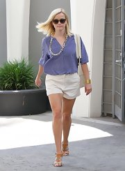 Reese showed off her preppy style with this loose, blue blouse with a delicate print.