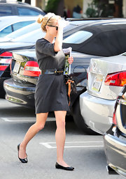 Hot Hollywood mama Reese keeps it cute and casual in a shiny pair of black patent leather flats.