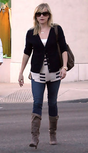 Reese Witherspoon looked stylish in casually chic taupe suede boots.