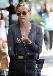 Reese opted for a summery pair of shades and sported the translucent, two-tone Wayfarers.