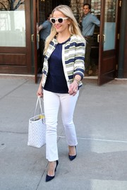 Reese Witherspoon went for casual sophistication in slightly flared jeans and a striped tweed jacket, both by Draper James, for a day out in New York City.
