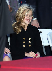 With her blond curls, Ava looks just like a doll.