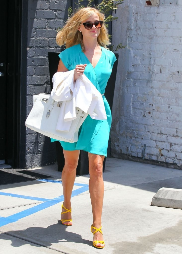 'The Good Lie' actress Reese Witherspoon getting her hair done at the Rossano Ferreti Hairspa in Beverly Hills, California on July 24, 2013. Rossano Ferreti was even there and he only comes to America a couple times a year.