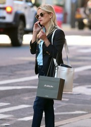 Reese Witherspoon was spotted out in New York City carrying a stylish white bucket bag by Proenza Schouler .