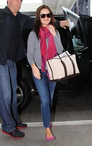 Reese chose this pink patterned scarf to add some color to her casual look while at LAX.