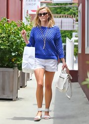 Reese chose a pair of crisp white shorts to pair with her sweater for a casual but preppy daytime look.