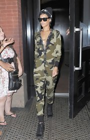Rihanna donned the camo look again when she chose a one-piece jumpsuit from her own collection.
