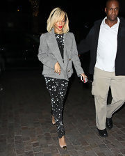 Rihanna paired her elegant jumpsuit with this heather gray coat.