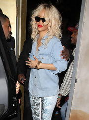 Rihanna went out to the Las Palmas nightclub in LA wearing her ultra-blond tresses in shiny voluminous curls.