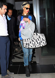 Rihanna kept her street style playful with a bone print duffle bag.